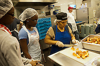 Volunteers and staff of St. John's Bread and Life, prepare and serve a Thanksgiving dinner for the neediest at their facilities in the Bedford-Stuyvesant neighborhood in Brooklyn in New York on Wednesday, November 21, 20012, the day before Thanksgiving. The soup kitchen serves over two thousand meals on a daily basis to the impoverished and working poor.  (© Richard B. Levine)