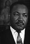loseup of Dr. Martin Luther King Jr waiting to speak at Alabama Church.