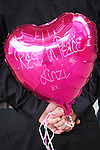 © Joel Goodman - 07973 332324 . 09/08/2013 . Salford , UK . A man holds a pink balloon with REST IN PEACE LINZI printed on it . The funeral of Linzi Ashton at St Paul's C of E Church in Salford , today (9th August 2013) . Linzi Ashton (25) was found murdered in her home on Westbourne Road in Salford on 29th June . Michael Cope is standing trial, accused of murdering, raping and assaulting her . Photo credit : Joel Goodman