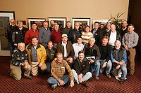 The Iditarod Airforce Volunteer pilots pose for a group photo at their final meeting before race time at the Millenium hotel in Anchorage.  These pilots fly thousands of hours in order to haul, food, fuel, vets, checkers, dropped dogs and officials along the 1200 miles of the race trail.    Iditarod 2009