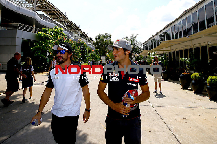 27.03.2011, Sepang-International-Circuit, Malaysia, MAL , Gro&szlig;er Preis von Malaysia / Kuala Lumpur, Vorbericht, im Bild<br /> <br />  Fernando Alonso (ESP),  McLaren F1 Team - Carlos Sainz Junior (SPA), Scuderia Toro Rosso<br /> for the complete Middle East, Austria &amp; Germany Media usage only!<br />  Foto &copy; nph / Mathis