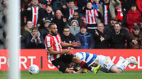 Ryan Manning of QPR brings down Brentford's Bryan Mbeumo during Brentford vs Queens Park Rangers, Sky Bet EFL Championship Football at Griffin Park on 11th January 2020