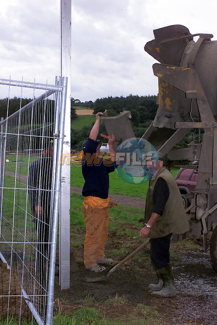Workmen putting 20 to 30 Foot High Steel Guirders in Place for the Huge gates in the run up to the two Slane Castle U@ concerts..Picture Fran Caffrey Newsfile.
