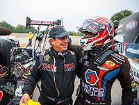 Aug 19, 2018; Brainerd, MN, USA; NHRA top fuel driver Billy Torrence (left) is congratulated by Antron Brown as he celebrates after winning the Lucas Oil Nationals at Brainerd International Raceway. Mandatory Credit: Mark J. Rebilas-USA TODAY Sports