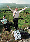 Sermon on the mount.....  Ebullient Kerry South Independent Jackie Healy-Rae preaching his election manifesto whioch included longer opening hours for pubs with his son Michael.<br />Picture by Don MacMonagle