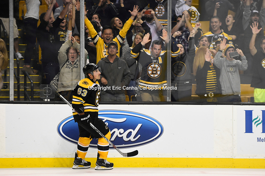 September 24, 2015 - Boston, Massachusetts, U.S. - Fans cheer Boston Bruins left wing Brad Marchand (63) after his game winning shoot-out goal during the NHL game between the New York Rangers and the Boston Bruins held at TD Garden, in Boston, Massachusetts. The Bruins defeat the Rangers 4-3 in overtime. Eric Canha/CSM