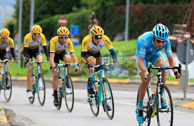 The peloton speed through Calco during the last classic of the season Il Lombardia 2015 running 245km from Bergamo to Como, Italy. 4th October 2015.<br /> Picture: Eoin Clarke   Newsfile