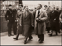 BNPS.co.uk (01202 558833)<br /> Pic: DukesAuctions/BNPS<br /> <br /> Edward, with Daimler chairman Dr Wilhelm Kissel (right) and Nazi party officials arrives at the factory.<br /> <br /> Remarkable photos of Edward VIII touring a car factory during his controversial visit to Nazi Germany in 1937 have been unearthed.<br /> <br /> Huge crowds turned out to catch a glimpse of the former King, rumoured to be a strong supporter of the Nazi party and the fascist cause, who even walked through a guard of Nazi troops giving Hitler salutes.<br /> <br /> The Duke of Windsor, who had abdicated the previous year, was accompanied by high ranking Nazi party officials and even an SS officer whilst touring the Mercedes-Benz factory in Stuttgart.<br /> <br /> During the trip, the Duke had a private meeting with Hitler at his retreat in Berchtesgaden and was infamously photographed giving Nazi salutes.