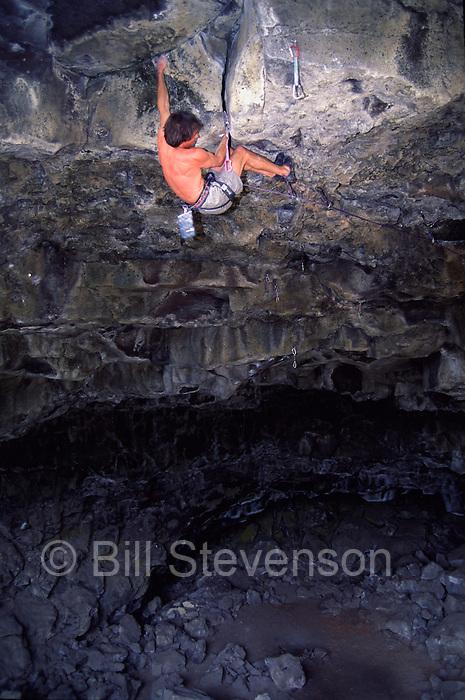 A photo of a man rock climbing at Skeleton Cave near Bend, Oregon