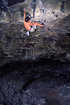 A photo of a man rock climbing at Skeleton Cave near Bend, Oregon