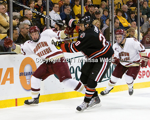 Patrick Brown (BC - 23), Luke Eibler (Northeastern - 20), Brooks Dyroff (BC - 14) - The Boston College Eagles defeated the Northeastern University Huskies 5-4 in their Hockey East Semi-Final on Friday, March 18, 2011, at TD Garden in Boston, Massachusetts.