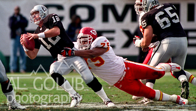 Oakland Raiders vs. Kansas City Chiefs at Oakland Alameda County Coliseum Sunday, November 5, 2000.  Raiders beat Chiefs  49-31.  Kansas City Chiefs defensive tackle Chester McGlockton (75) tackles Oakland Raiders quarterback Rich Gannon (12).