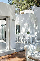 The deck and terrace have been furnished with as much careful thought as the internal rooms of this modern villa, where dining takes place as much outside as in.