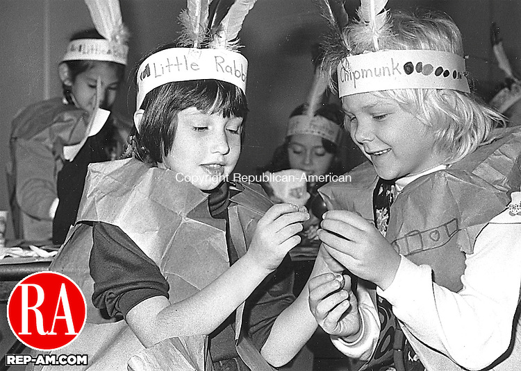 First-graders Ashley Hanneken and Erin Zwack dress as Indians on Wednesday at Quaker Farms School in Oxford to better understand the first Thanksgiving. <br /> Novebmer 26, 1992