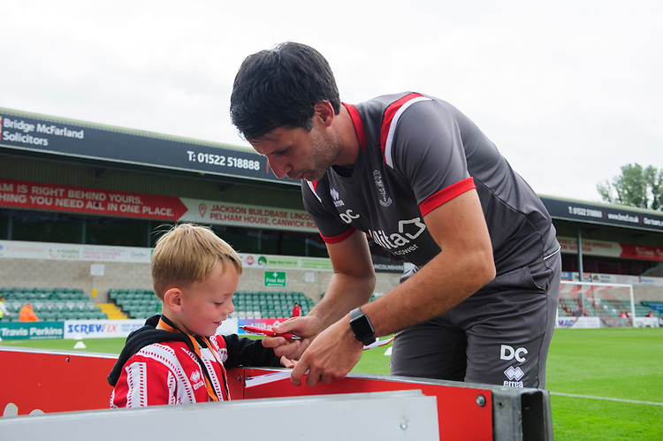 Lincoln City manager Danny Cowley signs an autograph for a fan<br /> <br /> Photographer Chris Vaughan/CameraSport<br /> <br /> Football Pre-Season Friendly - Lincoln City v Sheffield Wednesday - Saturday July 13th 2019 - Sincil Bank - Lincoln<br /> <br /> World Copyright © 2019 CameraSport. All rights reserved. 43 Linden Ave. Countesthorpe. Leicester. England. LE8 5PG - Tel: +44 (0) 116 277 4147 - admin@camerasport.com - www.camerasport.com