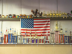 Trophies on shelves and american flag at Campbell's gymnastics, Clinton, CT