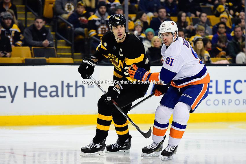 Monday, January 16, 2017: New York Islanders center John Tavares (91) and Boston Bruins defenseman Zdeno Chara (33) in game action during the National Hockey League game between the New York Islanders and the Boston Bruins held at TD Garden, in Boston, Mass. New York defeats Boston 4-0.  Eric Canha/CSM