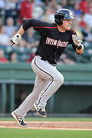 Catcher Jeremy Dowdy (25) of the Kannapolis Intimidators bats in a game against the Greenville Drive on Friday, April 11, 2014, at Fluor Field at the West End in Greenville, South Carolina. Greenville won, 13-2. (Tom Priddy/Four Seam Images)
