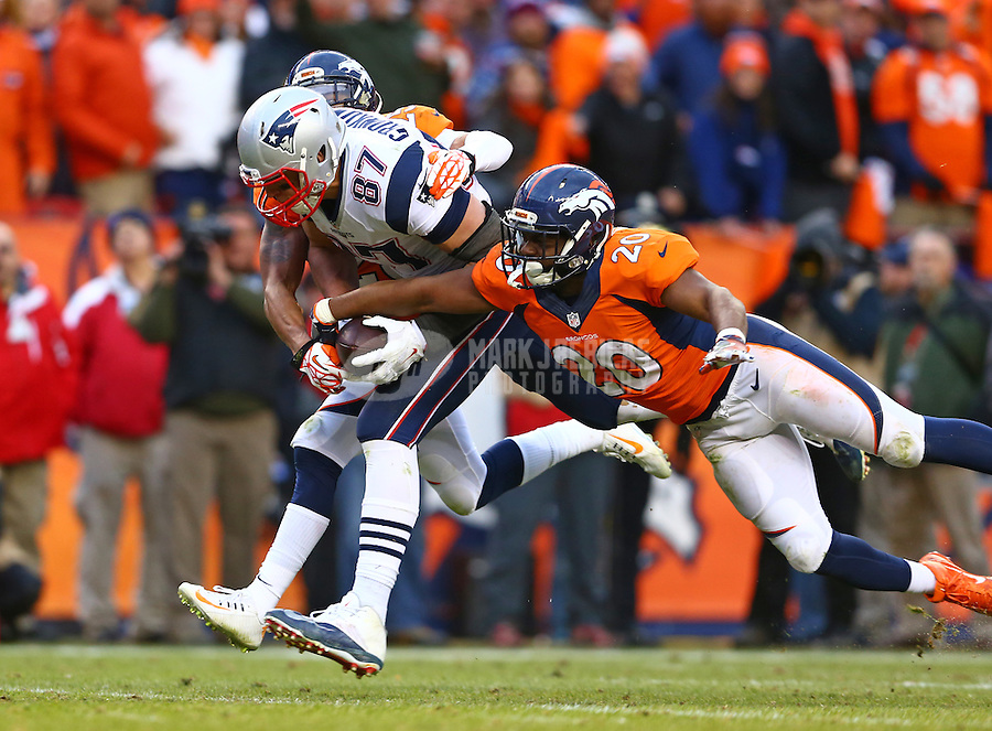 Jan 24, 2016; Denver, CO, USA; New England Patriots tight end Rob Gronkowski (87) is tackled by Denver Broncos safety Josh Bush (20) in the AFC Championship football game at Sports Authority Field at Mile High. Mandatory Credit: Mark J. Rebilas-USA TODAY Sports