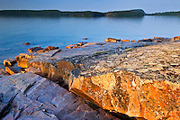 Rocky shoreline along Lake Superior at sunrise<br /> Rossport<br /> Ontario<br /> Canada