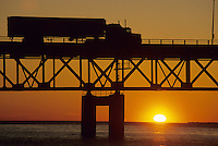 Truck moving at sunset on Mackinac Bridge, Michigan