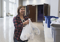 """Carlinda Pacheco of Bentonville reacts after picking up donations of toilet paper from Lead Pastor Mark Snodgrass (not pictured), Monday, March 16, 2020 at the Bentonville Community Church in Bentonville. Pacheco, a member of SOCO Church, spent the day picking up bags to distribute to people at her own church. She said she was motivated to do this after seeing empty shelves at 19 different stores she visited in search of toilet paper. """"My husband says I'm the toilet paper dealer,"""" she said jokingly. Check out nwaonline.com/200317Daily/ for todayÕs photo gallery.<br />(NWA Democrat-Gazette/Charlie Kaijo)<br /><br />Lead Pastor Mark Snodgrass donated rolls of church surplus toilet paper after finding the shelves empty over the weekend following recent updates on the coronavirus.<br /><br />""""I remembered we had gotten a shipment of toilet paper. It's not gonna do us any good sitting in a closet, he said adding that the church had moved it Sunday services online.<br /><br />He said several people had stopped by to pick up some rolls and one person even picked up rolls to distribute to others at another church. In addition, he said as many people stopped by to donate rolls.<br /><br />""""People have donated about 100 rolls today. I've almost received as much as I've donated,"""" he said. """"We're a church and we believe this kingdom that christ invites us to is a kingdom of abundance. When we give we find he continues to give and bless us. We want to model that for our community. We're gonna get through this."""""""