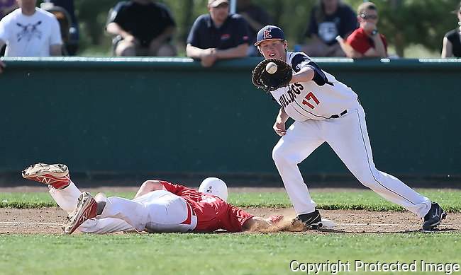 Ellensburg High School first baseman Cameron Curtis (17) reaches out for the ball during a failed pickoff attempt against Prosser's John Hanlon (9), Wednesday, May 8, 2013. (Brian Myrick / Daily Record)