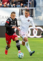 WASHINGTON, DC - MARCH 07: Eric Sorga #50 pushes forward past Ben Sweat #22 of Inter Miami during a game between Inter Miami CF and D.C. United at Audi Field on March 07, 2020 in Washington, DC.