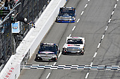 John Hunter Nemechek, NEMCO Motorsports, Chevrolet Silverado races Kyle Benjamin, DGR-Crosley, Toyota Tundra Crosley Brands/Tropicana to the finish line to win at Martinsville.