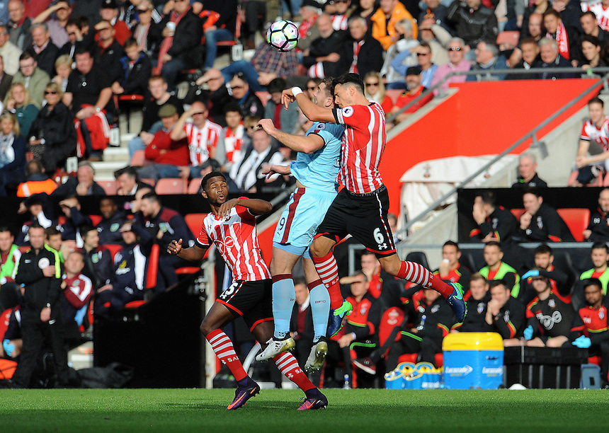 Burnley's Sam Vokes battles with Southampton's Jose Fonte for the header<br /> <br /> Photographer Ian Cook/CameraSport<br /> <br /> The Premier League - Southampton v Burnley - Sunday 16th October 2016 - St Mary's Stadium - Southampton<br /> <br /> World Copyright &copy; 2016 CameraSport. All rights reserved. 43 Linden Ave. Countesthorpe. Leicester. England. LE8 5PG - Tel: +44 (0) 116 277 4147 - admin@camerasport.com - www.camerasport.com