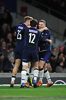 Finn Russell of Scotland celebrates scoring a try with team mates Chris Harris and Sam Johnson during the Guinness Six Nations Calcutta Cup match between England and Scotland at Twickenham Stadium on Saturday 16th March 2019 (Photo by Rob Munro/Stewart Communications)