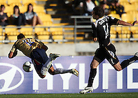 Tarek Elrich goes flying after contact with Daniel during the A-League match between Wellington Phoenix and Newcastle Jets at Westpac Stadium, Wellington, New Zealand on Sunday, 4 January 2009. Photo: Dave Lintott / lintottphoto.co.nz