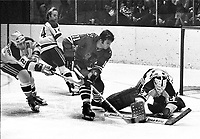 Seals vs. BlackHawks, Seals #2 Marshall Johnston, #14 Craig Patrick, goalie Giles Meloche defend Hawks .John Marks. (Ron Riesterer/photo 1971)