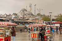 An early morning shower doesn't slow anything down at a street market in Istanbul near the Golden Horn.