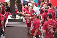 NWA Democrat-Gazette/J.T. WAMPLER University of Arkansas freshmen line up to touch the statue of William Fulbright before streaming through the rear doors of Old Main Sunday August 23, 2015 during a New Student Welcome event. New students arrived at the Fulbright Peace Fountain and heard from Todd Shields, dean of the Fulbright College of Arts and Sciences, before making their way through Old Main and a tunnel of student leaders, faculty and staff members welcoming them into the Razorback family.