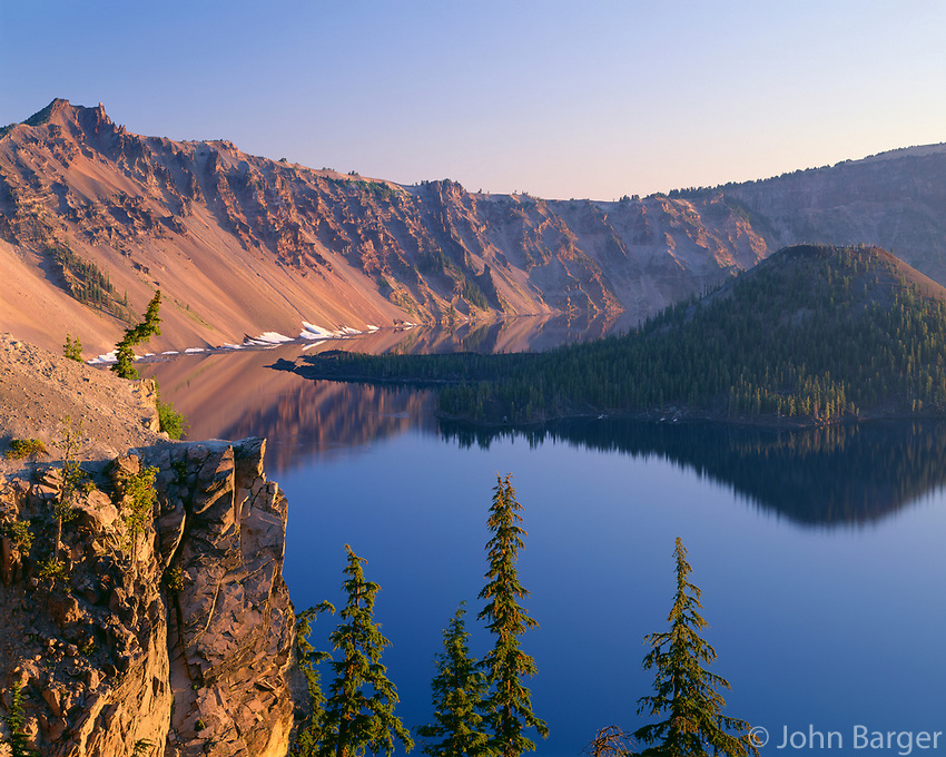 ORCL_043 - USA, Oregon, Crater Lake National Park, Sunrise glow on west rim of Crater Lake with Hillman Peak (left) overlooking Wizard Island.