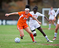 Ally Andreini (27) of Miami holds off Shade Pratt (22) of Maryland during the game at Ludwig Field in College Park, MD.  Maryland defeated Miami, 2-1, in overtime.