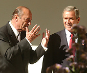 United States President George W. Bush and French President Jacques Chirac make remarks to the press after their talks in the Oval Office of the White House in Washington, DC on November 6, 2001.  The Presidents continued their meetings over lunch in the White House Residence.<br /> Credit: Ron Sachs / CNP