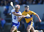Stephen Daniels of Waterford  in action against Ian Galvin of Clare during their National League game at Cusack Park. Photograph by John Kelly.