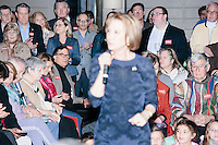 People listen as Republican presidential candidate Carly Fiorina speaks at a town hall campaign event at LaBelle Winery in Amherst, New Hampshire.
