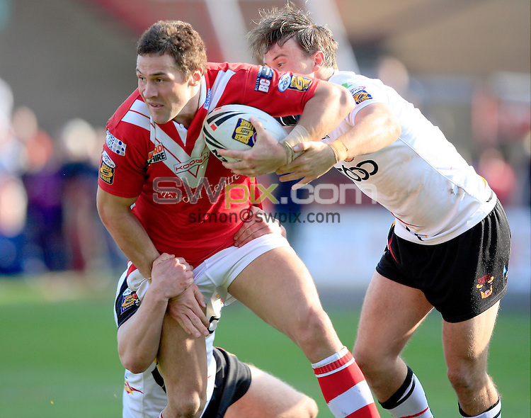 PICTURE BY CHRIS MANGNALL /SWPIX.COM...Rugby League - Super League  - Salford City Reds v Bradford Bulls  - The Willows, Salford, England  - 16/04/11... Salford's Vinnie Anderson  tackled by Bradford's Tom Olbison and Mark Herbert
