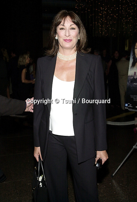 Angelica Huston arriving at the premiere of Mist of Avalon at the Director Guild of America in Los Angeles. The Mist of Avalon is the legendary story of Camelot seen through the eyes of the women who wielded power behind King Arthur throne. June 25, 2001  © Tsuni          -            HustonAngelica14.jpg