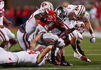 Ohio State Buckeyes running back Dontre Wilson (1) gets dragged down by Wisconsin Badgers safety Nate Hammon (14) in the third quarter of the NCAA football game at Ohio Stadium in Columbus, Saturday evening, September 28, 2013. The Ohio State Buckeyes defeated the Wisconsin Badgers 31 - 24. (Columbus Dispatch  / Eamon Queeney)
