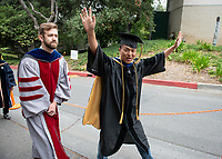 Brandon Lehr and Sophal Ear<br /> Families, friends, faculty, staff and distinguished guests celebrate the class of 2018 during Occidental College's 136th Commencement ceremony on Sunday, May 20, 2018 in the Remsen Bird Hillside Theater.<br /> (Photo by Marc Campos, Occidental College Photographer)
