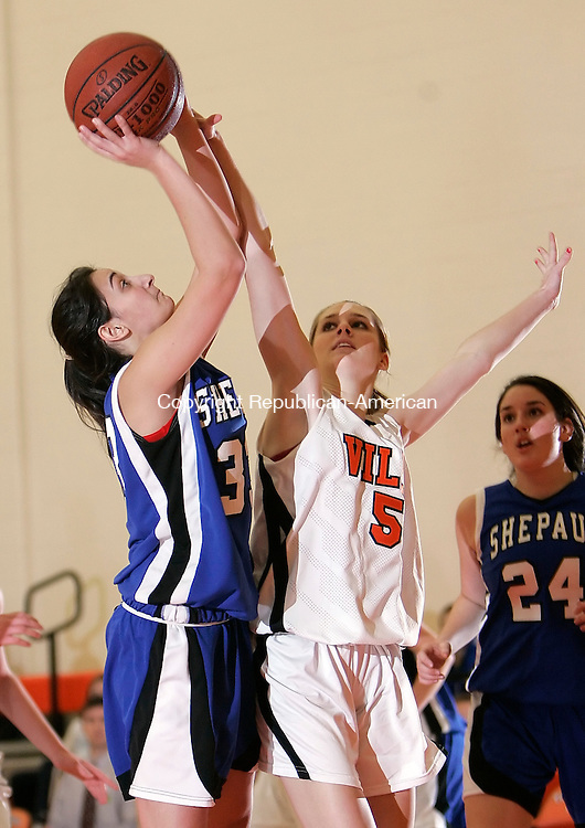 TERRYVILLE, CT, 12/12/08- 121208BZ11- Shepaug's Jackie DeVito (33) shoots under pressure from Terryville's Sam Hanlon (5) during their game at Terryville High Friday night.<br /> Jamison C. Bazinet Republican-American