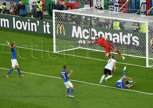 02.07.2016. Bordeaux, France.  Italy's Graziano Pelle, Emanuele Giaccherini, goalkeeper Gianluigi Buffon, watch as Germnany's Bastian Schweinsteiger chance is saved during the UEFA EURO 2016 quarter final match