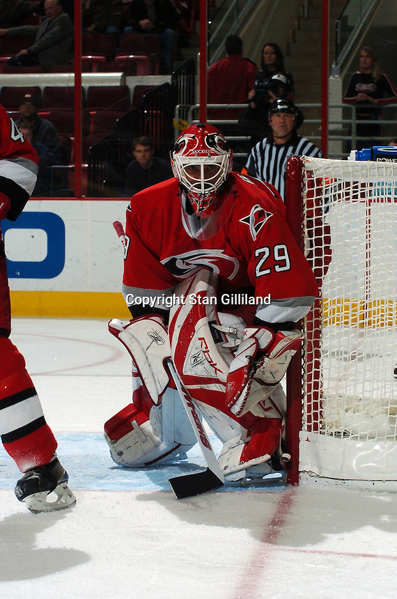 Carolina Hurricanes' goaltender Martin Gerber of Switzerland keeps an eye on the puck during a game with the New York Rangers Thursday, Nov. 17, 2005 in Raleigh, NC. Carolina won 5-1.
