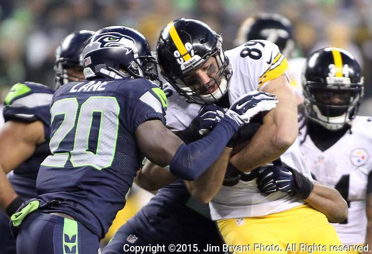 Seattle Seahawks cornerback Jeremy Lane (20) tackles Pittsburgh Steelers tight end Matt Spaeth (89) at CenturyLink Field in Seattle, Washington on November 29, 2015.  The Seahawks beat the Steelers 39-30.      ©2015. Jim Bryant Photo. All Rights Reserved.