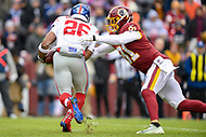 Landover, MD - December 9, 2018: New York Giants running back Saquon Barkley (26) is tackled in the backfield by Washington Redskins outside linebacker Ryan Kerrigan (91) during game between the New York Giants and Washington Redskins at FedEx Field in Landover, MD. The Giants defeated the Redskins 40-16 dropping the Redskins to 6-7 on the season. (Photo by Phillip Peters/Media Images International)