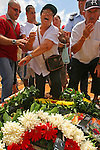 Israeli relatives of Aryeh and Tiran Taamam, gather around their bodies, during their funeral, in Akko, northern Israel, Sunday, Aug. 6, 2006. The two Taamam brothers were killed Thursday in a Hezbollah rocket attack JINI/ANCHO GOSH/EPA